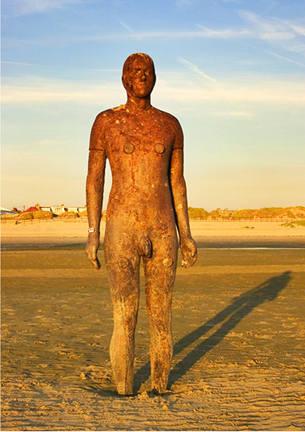 Antony Gormleys Another Place Iron Man Photographic Print Antony Gormley sculpture-600