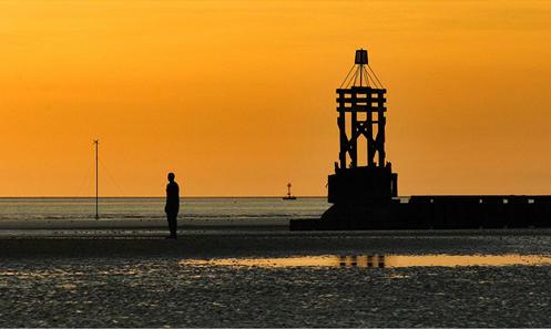 Antony Gormleys Another Place Iron Man Photographic Print