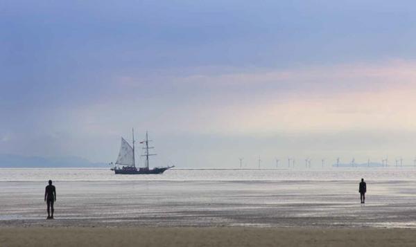 Antony Gormleys Iron Men with ship passing Photographic Print