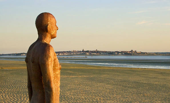 Antony Gormley's Another Place Iron Man sculpture photographic print