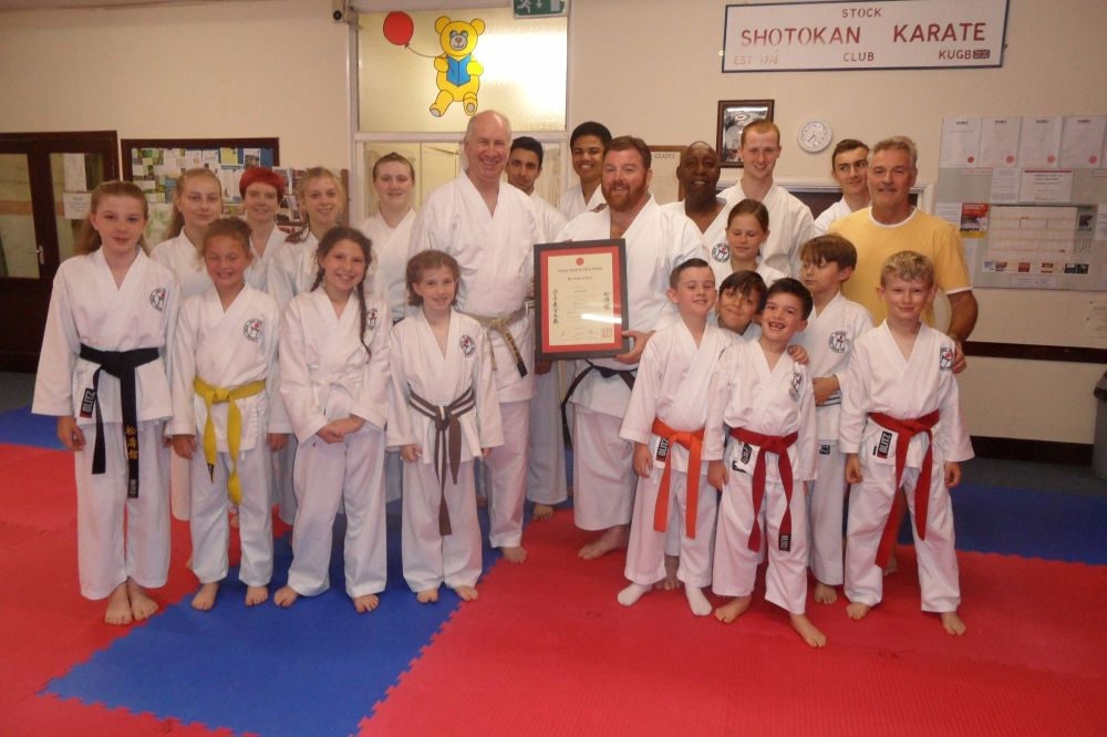 Sensei Poynton presents Sensei Adam his 5th Dan certificate