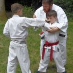 Sensei Adam helps Alfie with Josh