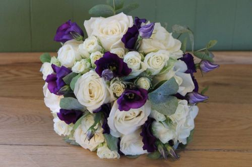 ivory and purple brides bouquet