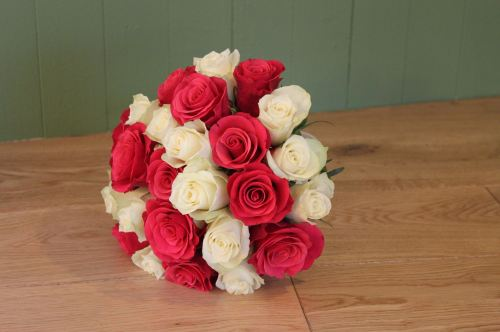 ivory and cerise rose brides bouquet