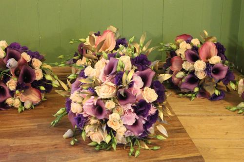 rose lisianthus and calla lily brides bouquet