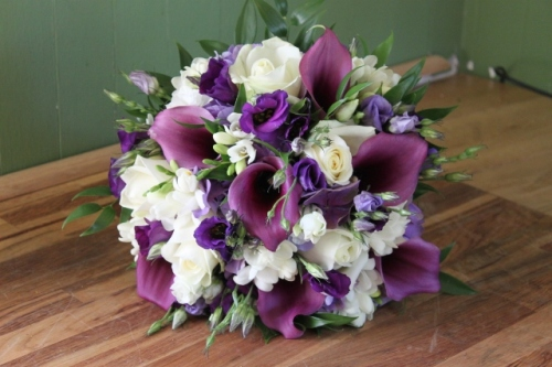 ivory rose and purple calla lily brides bouquet