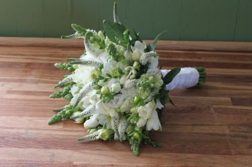 white dahlia veronica and snapdragon brides bouquet