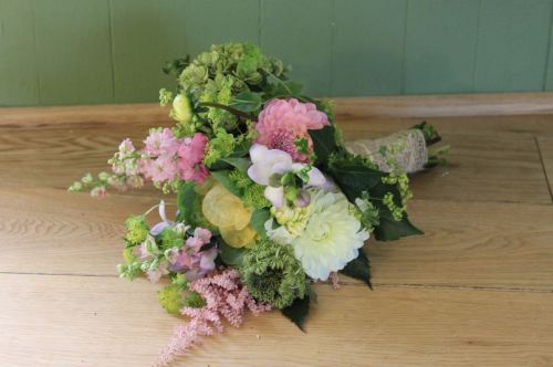 green pink country brides bouquet