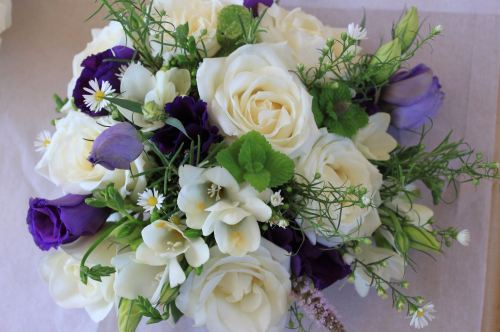 avalanche rose lisianthus and herb bridal bouquet