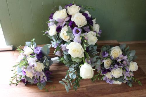 avalanche rose and lisianthus brides shower bouquet