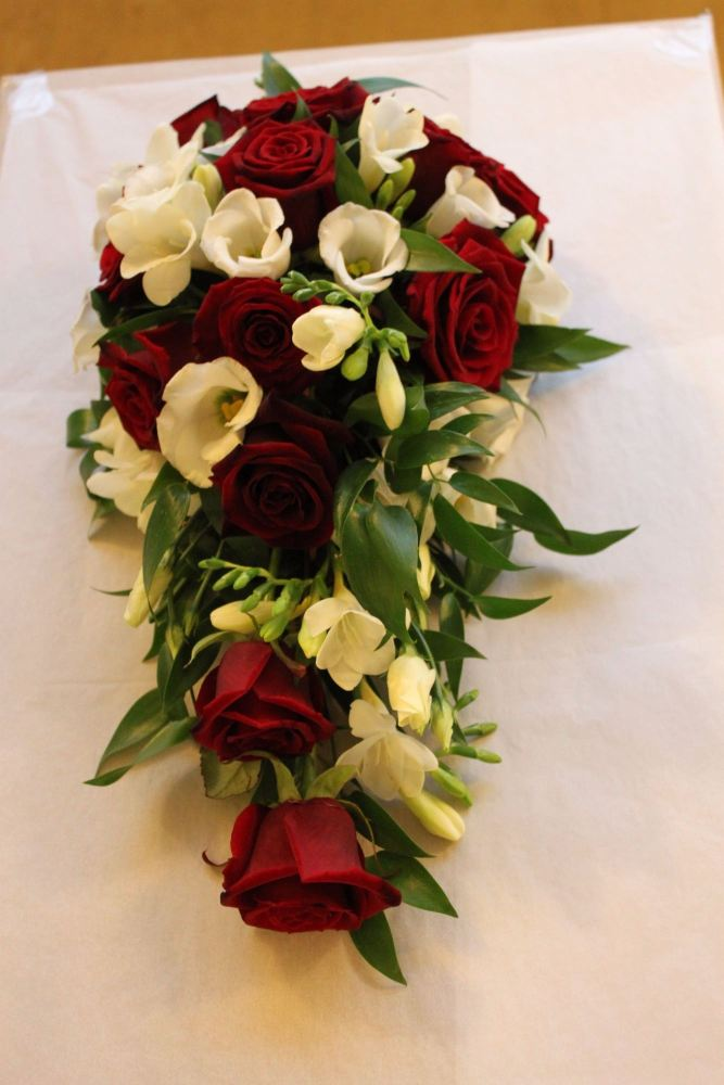 red rose and freesia brides shower bouquet