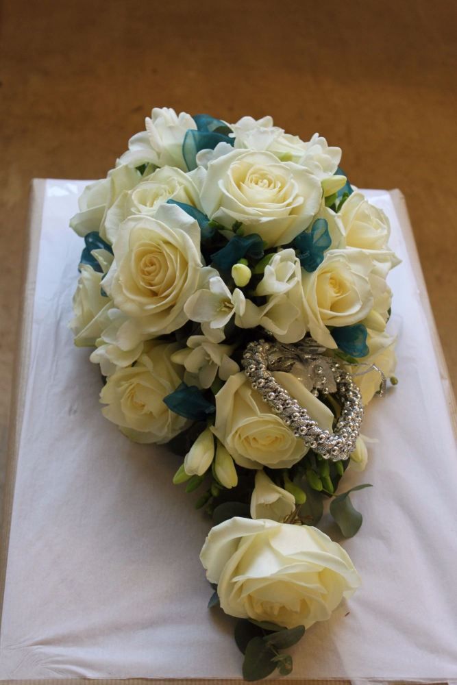 ivory rose and freesia brides shower bouquet
