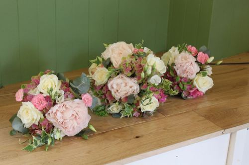 pink peony and hydrangea bridesmaids bouquets
