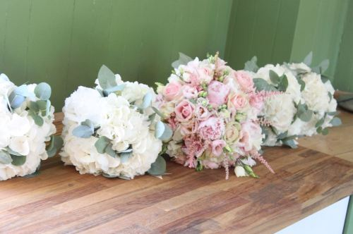 white hydrangea bridesmaids bouquets