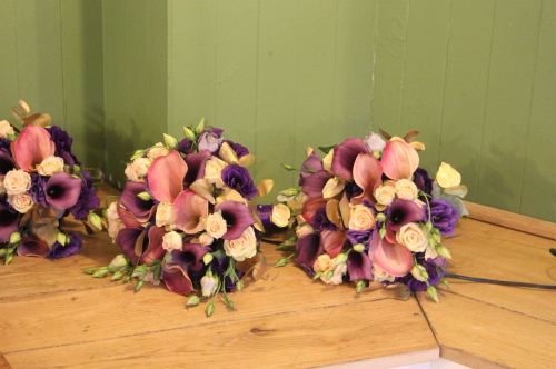 rose and calla lily bridesmaids bouquets