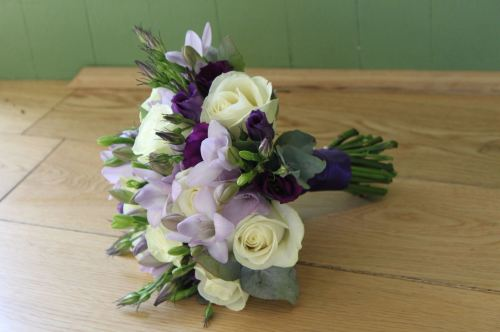 purple and ivory bridesmaids bouquet