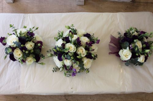 purple and white rose bridesmaids bouquet