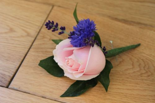 rose and cornflower button holes