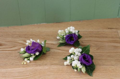 lisianthus and lily of the vally button holes