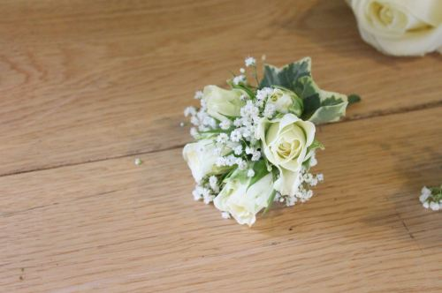 rose and babies breath corsage