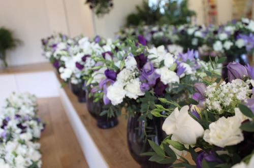 white and purple vase arrangements