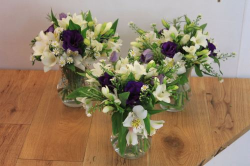 lisianthus and freesia table arrangements