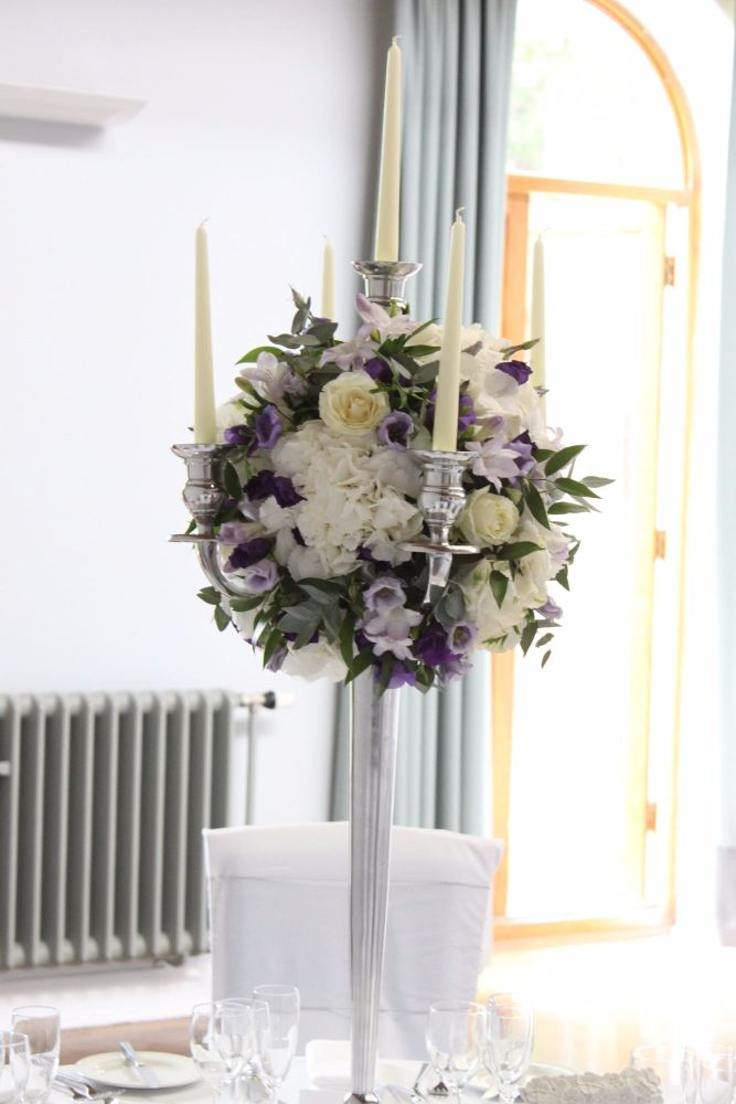 white and purple candelabra
