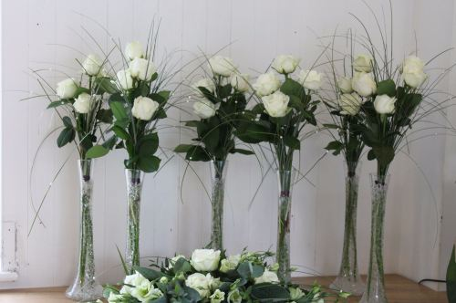 avalanche rose tall table arrangements