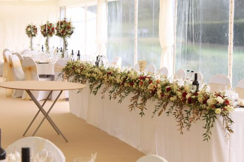 ivory and red top table arrangement
