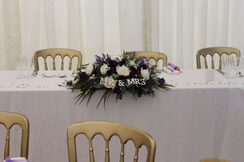 white and purple top table arrangement