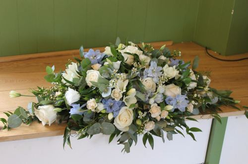 rose and delpinium top table arrangement