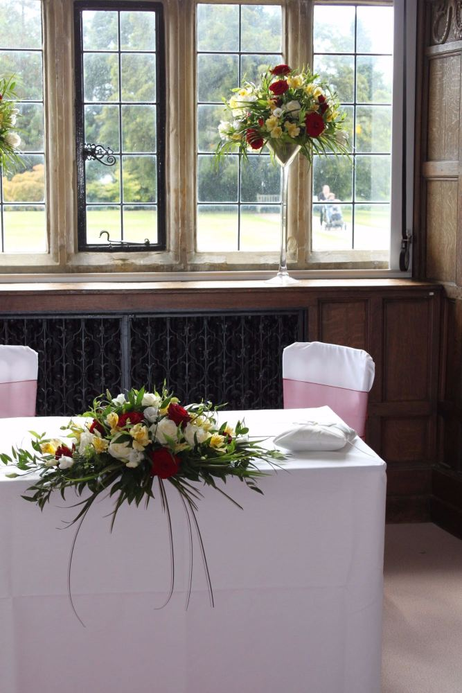 red and cream top table arrangement