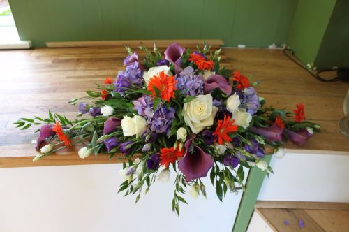 purple and orange top table arrangement
