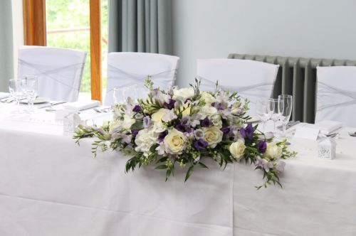 ivory and purple top table arrangement