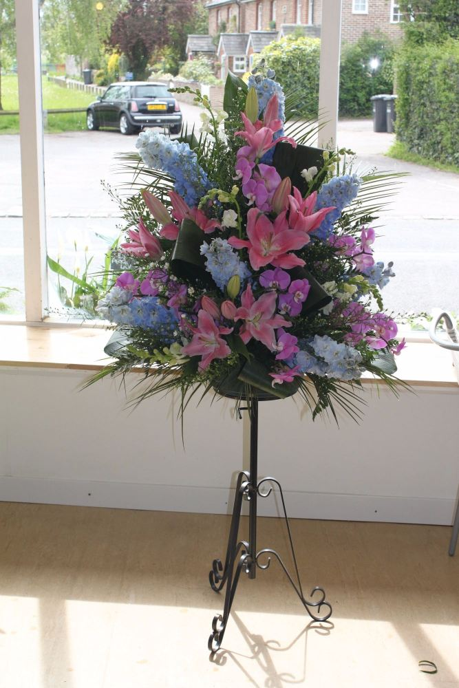 lily and delphinium pedestal arrangement