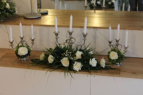 white candelabra top table
