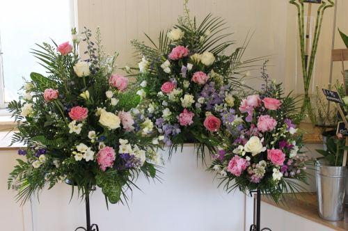 peony and rose pedestal arrangement
