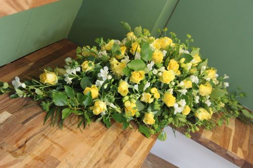 yellow rose and freesia spray
