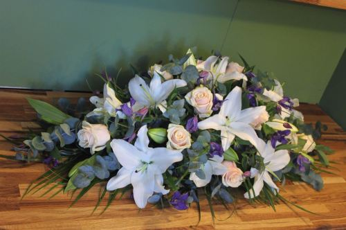 rose lily and clematis spray