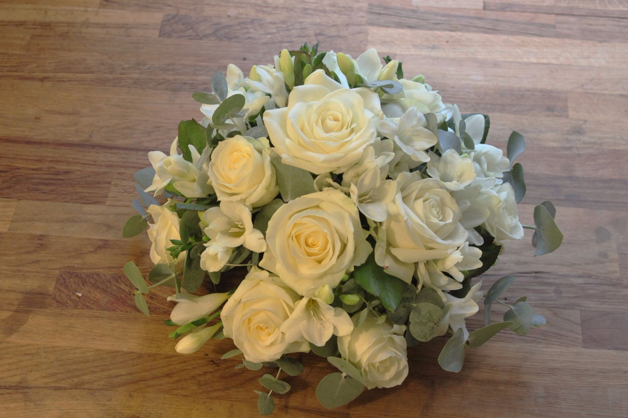 Ivory rose and white freesia posy