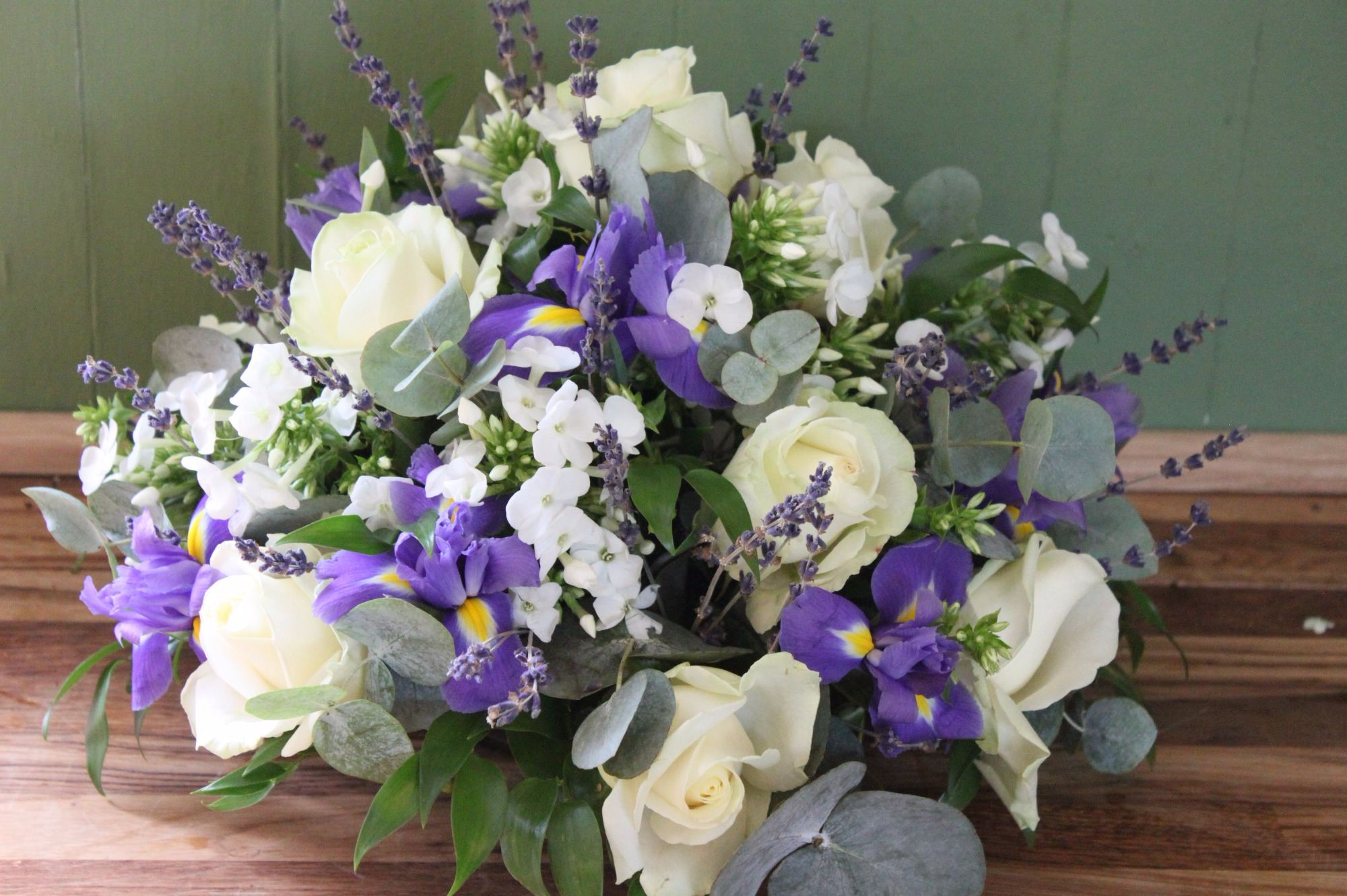 Ivory rose, purple iris and white phlox posy