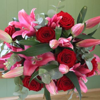 A Pink Lily and Red Naomi Rose Valentine's Bouquet. Price from