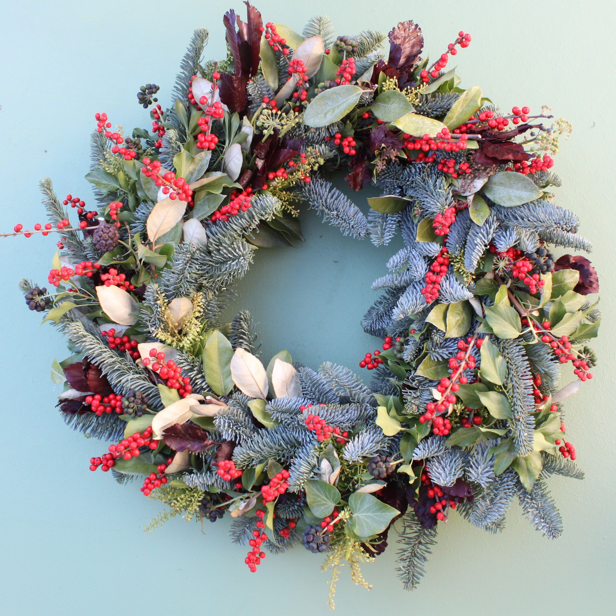 ilex and foliage christmas door wreath