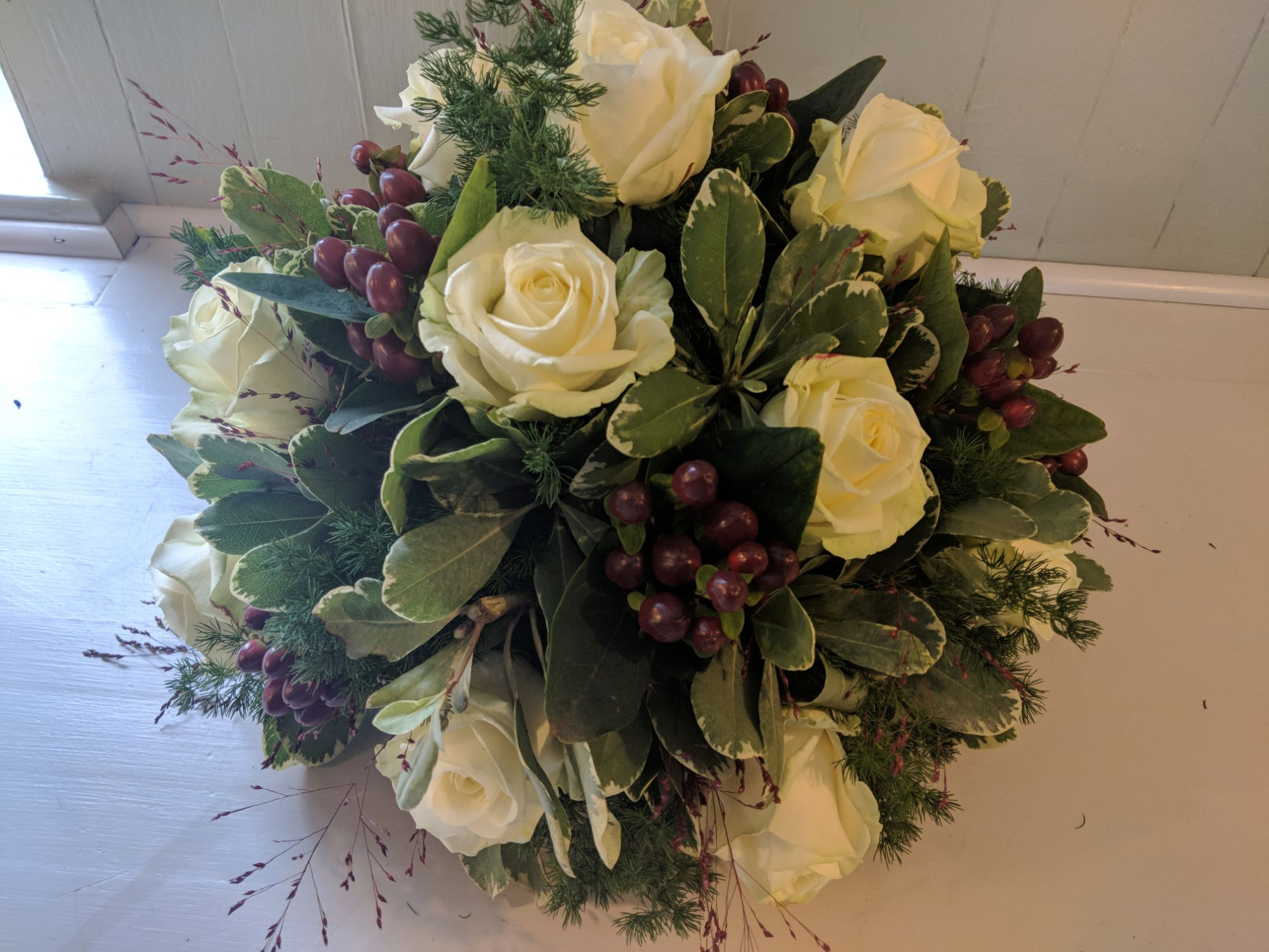 Ivory rose and burgundy berry posy