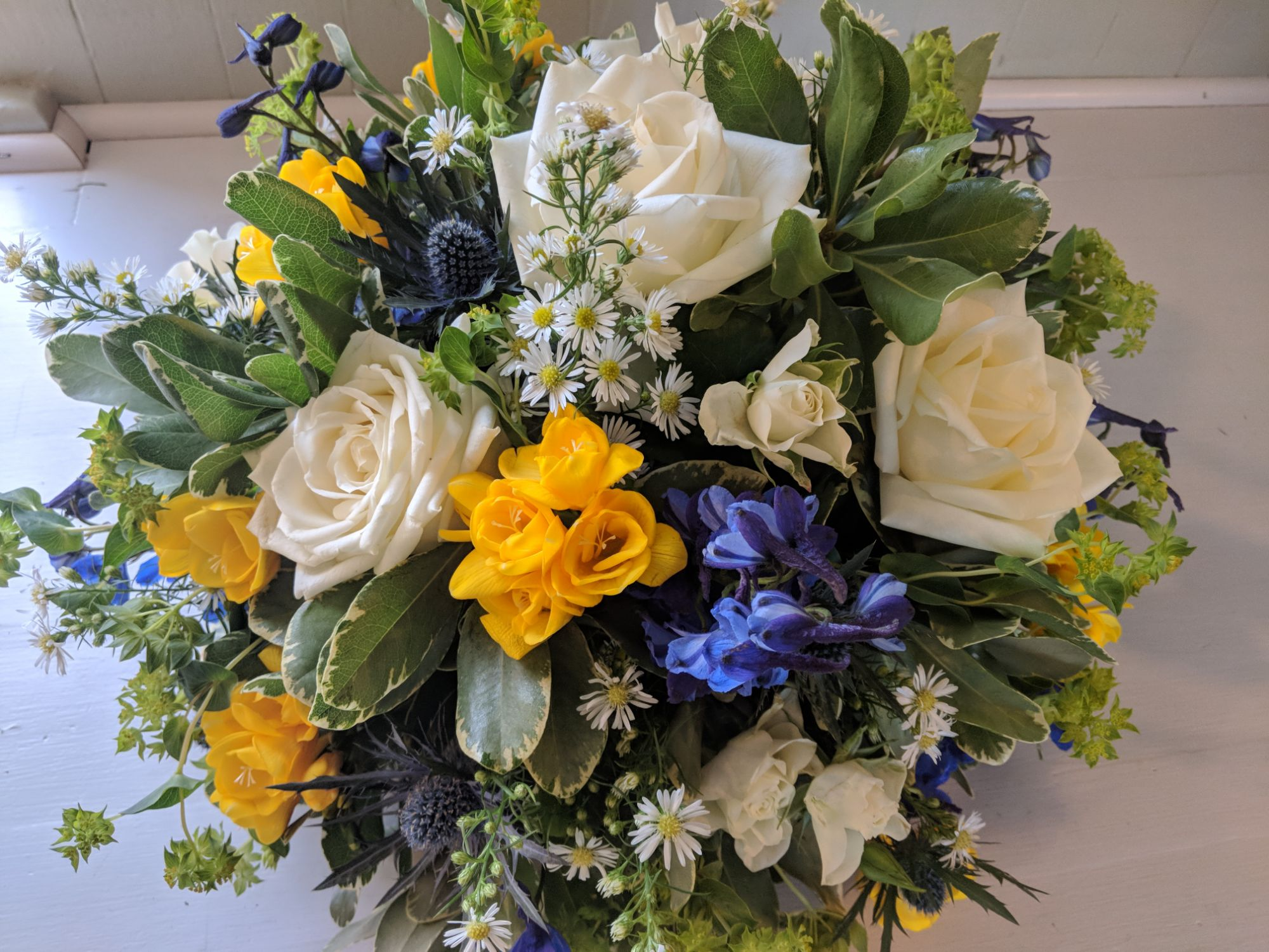 Yellow, white and blue posy