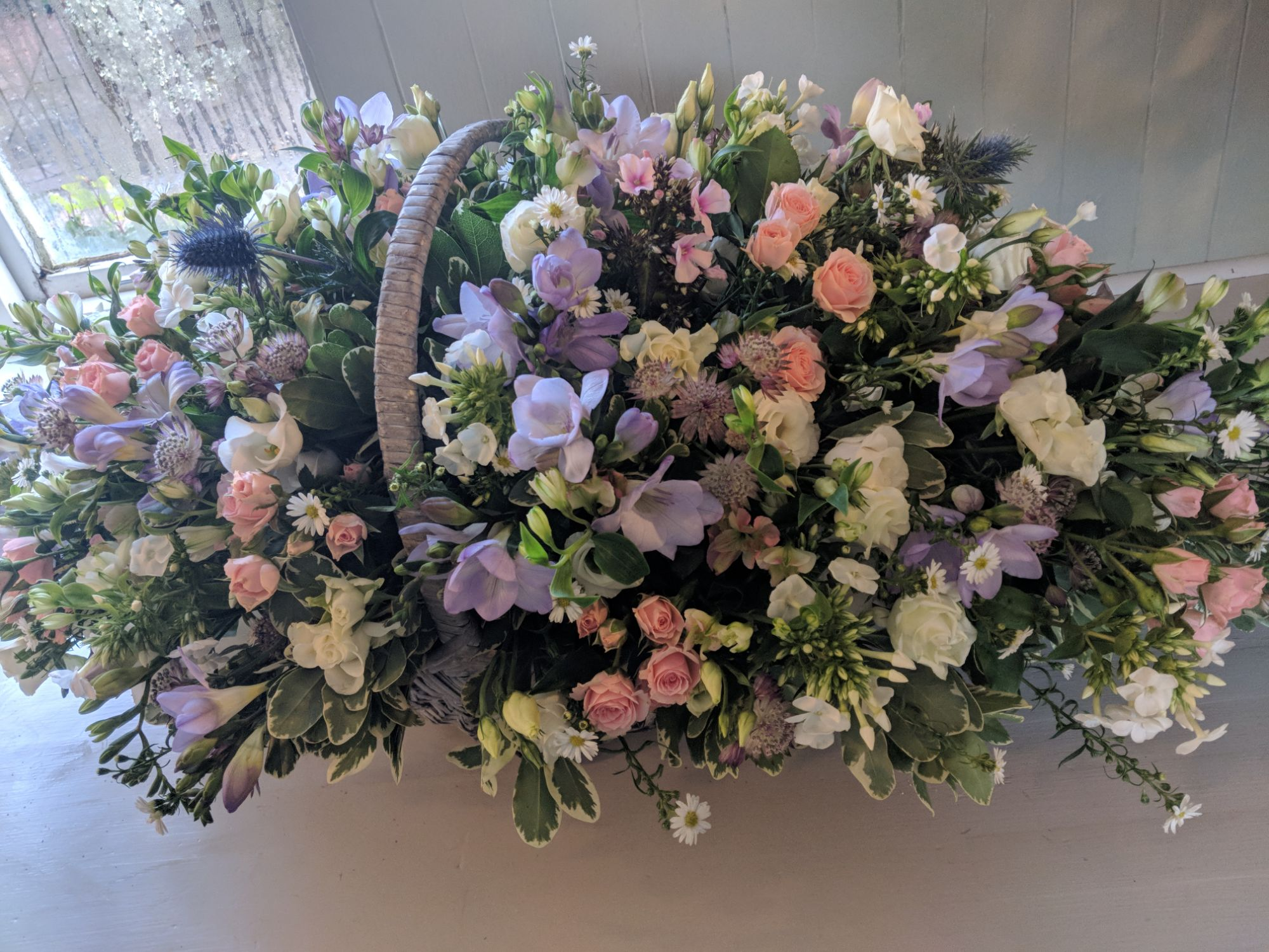 basket of flowers funeral arrangement Newick