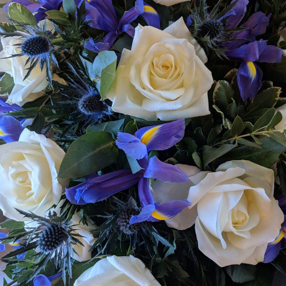 Ivory Rose, Purple Iris & Blue Thistle Coffin Spray