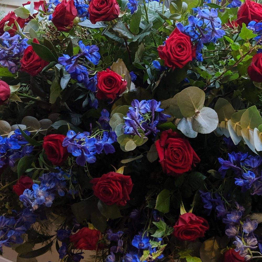 Red Rose & Royal Blue Delphinium Coffin Spray