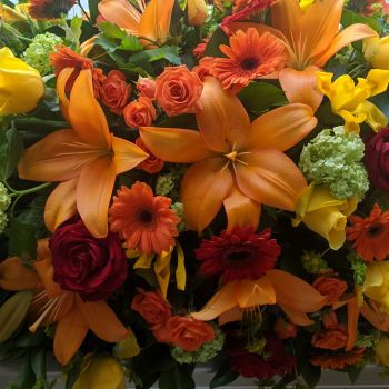 Orange, Red. Yellow & Lime Seasonal Coffin Spray