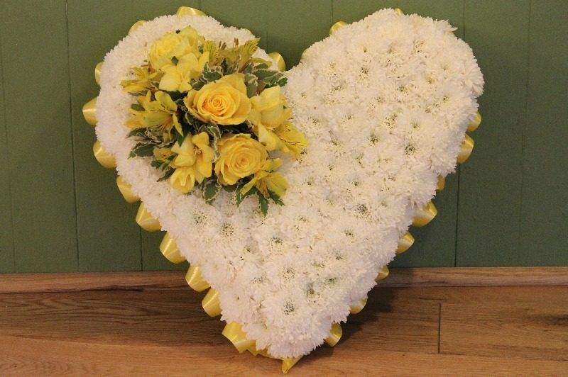 c1 white and yellow based heart